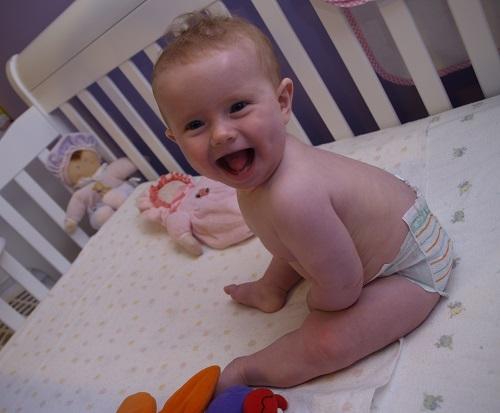 baby sitting in crib